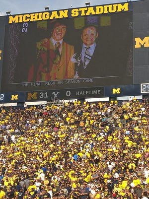 The videoboard at Michigan Stadium displays a photo of Rob Lytle and coach Bo Schembechler during a ceremony honoring Lytle's election to the College Football Hall of Fame at halftime of Michigan's game against BYU on Sept. 26, 2015.