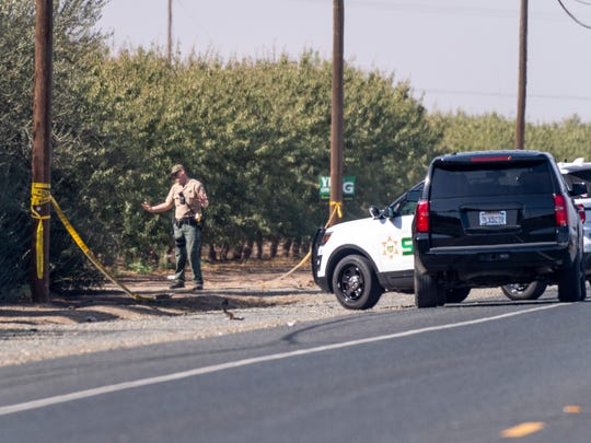 Tulare County Sheriff Department investigates a double shooting resulting in at least one homicide along Avenue 232 between Roads 180 and 188 on Tuesday, October 23, 2018.