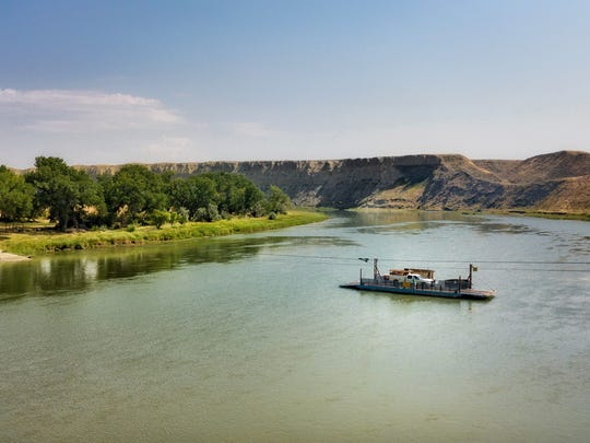 The Virgelle ferry carries a Hill County Electric Cooperative pickup across the Missouri River. Using the ferry to reach customers shaves off a half hour of driving.