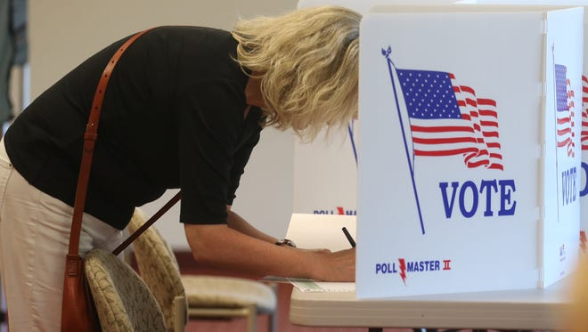Beth Hasbe of Pittsford marks her primary ballot Tuesday before casting it at Pittsford Community Church.