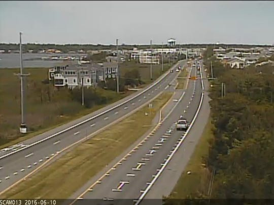 In this image taken from a Delaware Department of Transportation camera, traffic drives on Del. 1 in Dewey Beach on Friday.