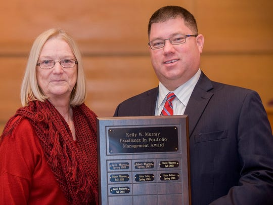 David Weatherly, who graduated Dec. 13 from the University of Tennessee at Martin, received the Kelly W. Murray Excellence in Portfolio Management Award for the fall semester. Sandra Murray, associate professor of education, is pictured with Weatherly following the presentation Dec. 3.