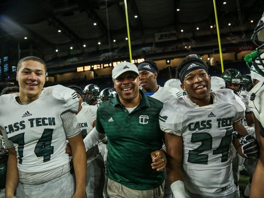 Detroit Cass Tech's players celebrate with head coach
