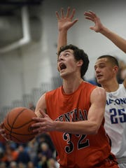 Central York's Evan Czulaba (32) pushes past Cedar Crest's Cole Laney (25) during Saturday's game.