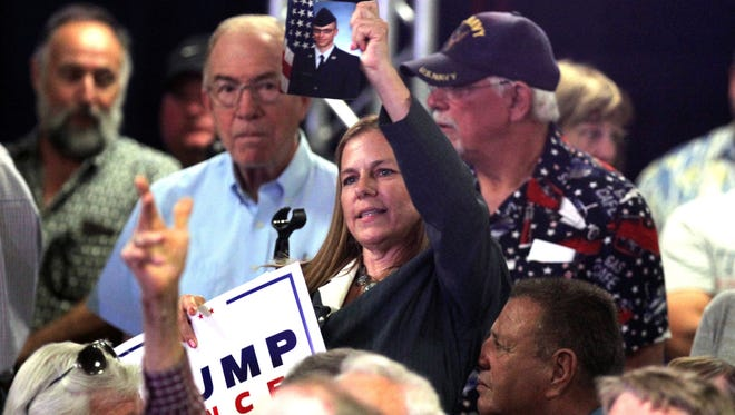 Catherine Byrne holds a picture of her son at a Trump rally in Nevada on August 1, 2016.