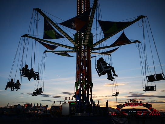 Kids ride on a carnival ride at the San Angelo Stock