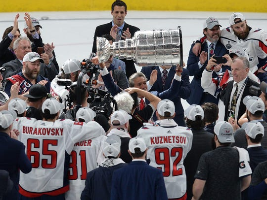 Washington Capitals players watch owner Ted Leonsis