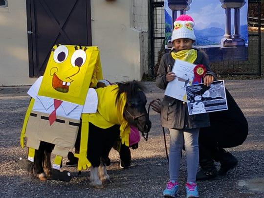 Abigail Rosa, grade 2, with her Sponge Bob design for Little Annie of Team Velvet.