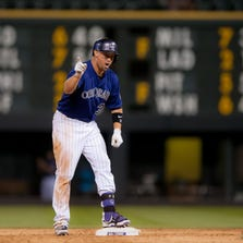DENVER, CO - AUGUST 17:  Michael Cuddyer #3 of the Colorado Rockies asks for the ball to keep as a memento after he doubled, knocking in two runs and completing the cycle in the eighth inning during the second game of a split double header at Coors Field on August 17, 2014 in Denver, Colorado.  (Photo by Dustin Bradford/Getty Images)