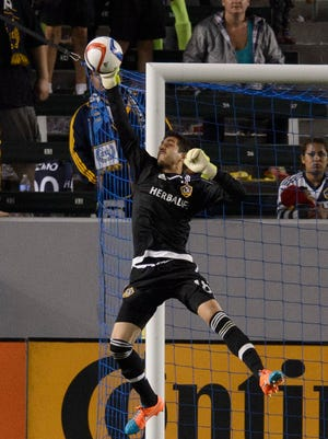 Jaime Penedo (18) makes a save against the Colorado Rapids during the second half at StubHub Center. The game ended in a draw with a final score of 1-1.