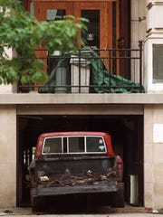 The truck that was rammed into the east side of the Tippecanoe County Courthouse, containing an apparent explosive device, sits partially outside of the building Monday morning. The truck was farther in the building and apparently moved closer to the doors that it rammed. (3 aug. 98)