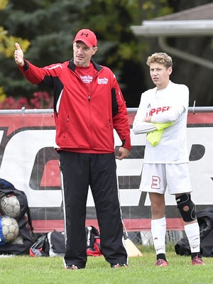 Sturgeon Bay soccer coach Todd Maas instructs player Gunnar Tebon.