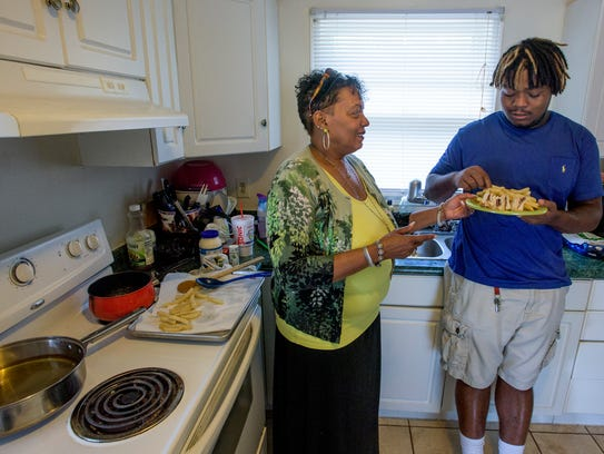 Sophia Dowdell and her son Chris at their home in Montgomery,