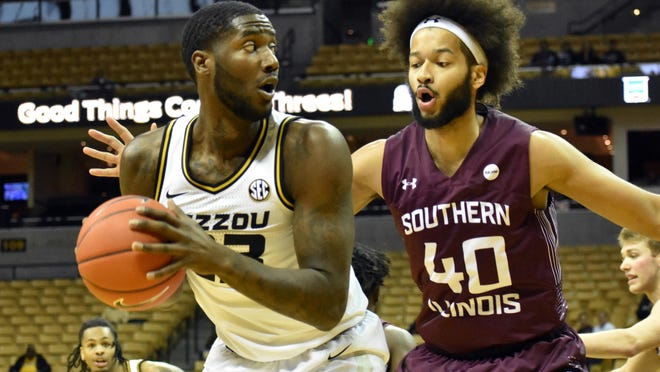 Missouri center Jeremiah Tilmon (23) looks to pass the ball while Southern Illinois' Barret Benson (40) guards him during a game in December at Mizzou Arena.