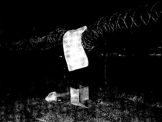 A court filing connected with the January 2017 escape features an image of the remains of the escape path, a mattress placed over razor wire at the perimeter fence.