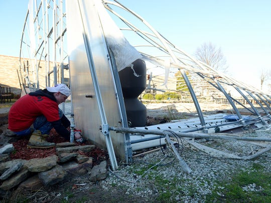 Isaac Goney helps disassemble the greenhouse that once stood at Crockett County High School. The greenhouse suffered damage after an EF-1 tornado touched down in the area Tuesday.