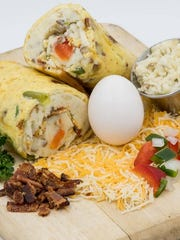 Handy's Restaurant served a handheld breakfast similar to a breakfast burrito but using an rolled egg omelette instead of a tortilla.