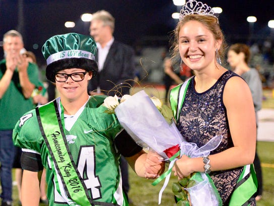 Novi's homecoming king was Robby Heil, flanked by the
