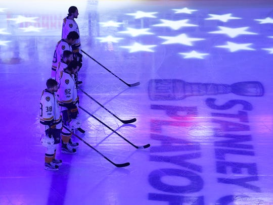 The Predators line up for the National Anthem before