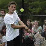 Anthony Bosch, Covington Catholic's No. 1 singles player, won his opening round matchup.