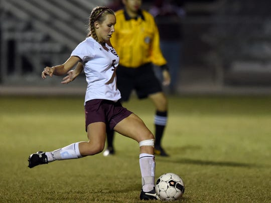 Maddie Griggs of Henderson County scores on a penalty kick against Hopkinsville goalkeeper Meredith Pace during the second half of the girls Second Region championship at Colonel Field in Henderson Thursday.  The Colonels won 4-0.