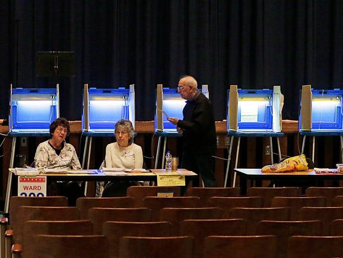 A voter casts a ballot inside Ronald Reagan High School