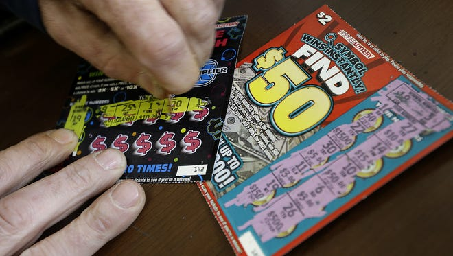 Hoosier Lottery scratch-off tickets are played by gamers at the Rickers gas station and convenience store at 5201 N Keystone Ave.