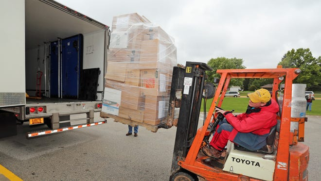 Pallets of donations from many portions of Wisconsin are loaded into a semi trailer Friday September 30, 2016 in Plymouth.
