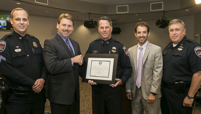 From left are Sgt. Kyle Evans, Chief Jeff Hughes of the Brentwood Police Department, Police Chief Karl Durr,  Mayor Shane McFarland and Assistant Chief Eric Cook.