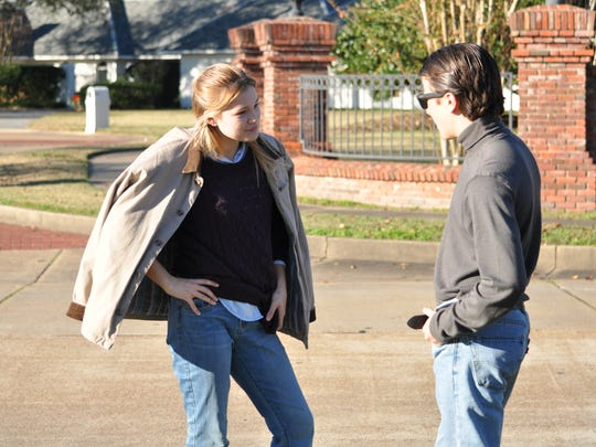 """(From left) Actors Olivia Holt and Skyler Gisondo talk in between filming scenes for """"Class Rank"""" on Tuesday. The movie is being filmed in Alexandria and Pineville this month."""