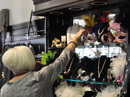 Jackie Elliot shops for Mardi Gras gifts on Wednesday afternoon at Sassy Girl in Alexandria