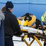 Boston Pride's  Denna Laing is wheeled off the ice after being injured during a women's hockey game against the Montreal Les Canadiennes at Gillette Stadium in Foxborough, Mass.