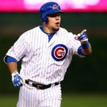 October 13, 2015; Chicago, IL, USA; Chicago Cubs left fielder Kyle Schwarber (12) reacts after he hits a solo home run in the seventh inning against St. Louis Cardinals in game four of the NLDS at Wrigley Field. Mandatory Credit: Jerry Lai-USA TODAY Sports