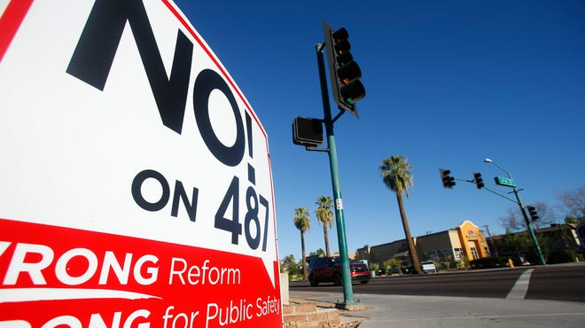 A Proposition 487 sign sits on the corner of McDowell and Third Street on Sunday, Sept. 14, 2014.
