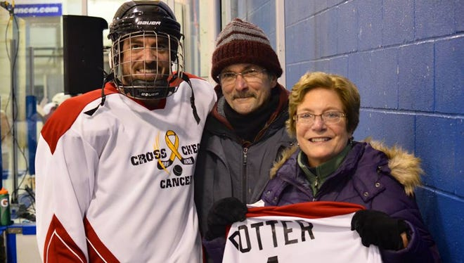 Gordon Potter, left, and his parents, Doug and Sarah Potter, after last year's Crosscheck Cancer game at Bill Gray's Regional Iceplex. Doug Potter, 64, is a cancer survivor and was awarded an honorary jersey.