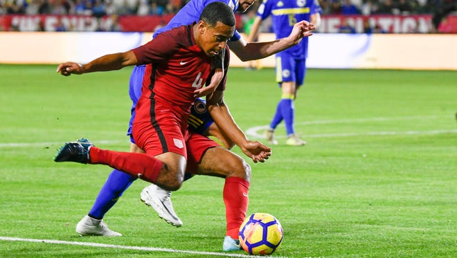 U.S. midfielder Tyler Adams, a Wappingers Falls native, attempts to cross the ball defended by Bosnia and Herzegovina's Almir Bekic, at Stub Hub Center in Carson, California earlier this year.