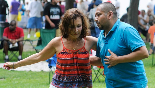 People dance at the Poughkeepsie Latin American Festival on Saturday in Poughkeepsie.