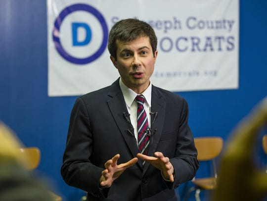 South Bend Mayor Pete Buttigieg speaks to the media,