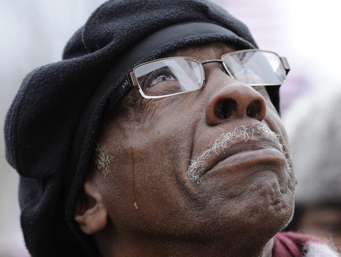 Joseph McPherson from Hartsville, S.C., gets emotional as he watches the inauguration of President Obama on a large television screen set up on the National Mall on Jan. 20 in Washington.