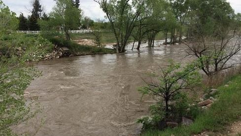 The Poudre River is running high under N. Shields in Fort Collins on May 24, 2014.