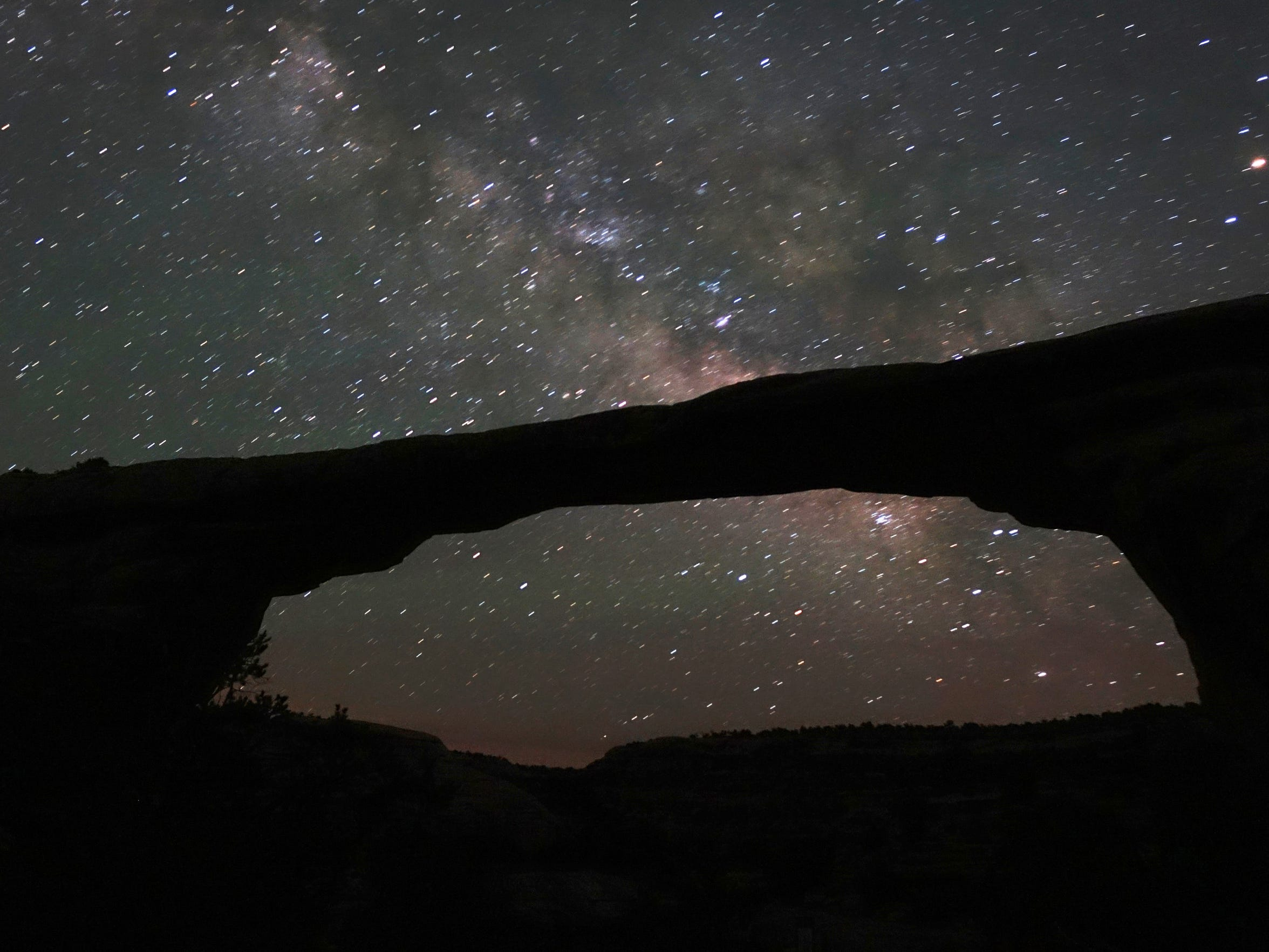 There are more trees on Earth than stars in the Milky Way. In this photo, the Milky Way shines through Owachomo Bridge at Natural Bridges National Monument, one of the darkest places in the lower 48 states, in this long exposure photograph.