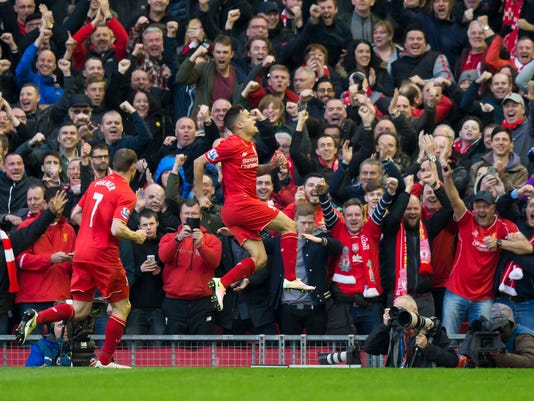Liverpool's Philippe Coutinho, centre, celebrates after scoring during the English Premier League soccer match between Liverpool and Tottenham Hotspur, at Anfield Stadium, Liverpool, England, Saturday, April 2, 2016. (AP Photo/Jon Super)
