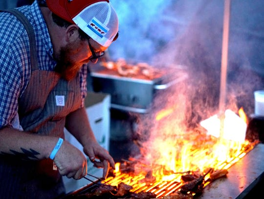 Denver chef Justin Brunson grills meat over flames