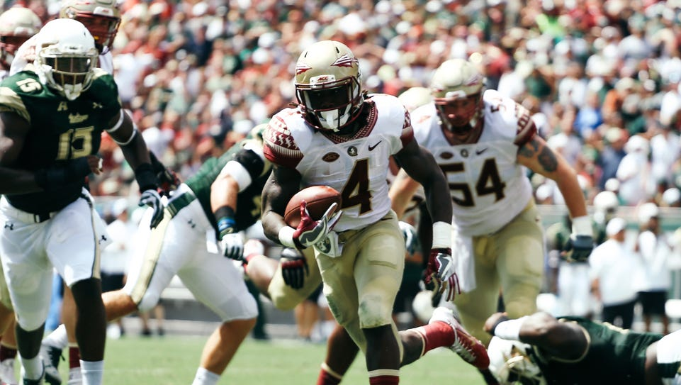 Dalvin Cook (4) rushes for a touchdown during the first