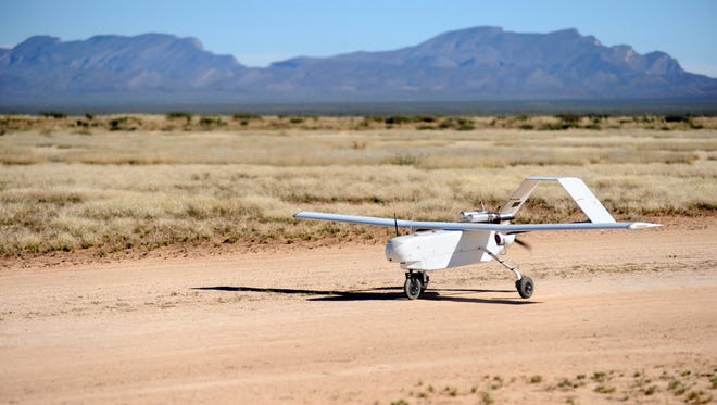 An unmanned aerial vehicle from the New Mexico State University Unmanned Aircraft Systems Flight Test Center makes its way down the runway on the Jornada Experimental Range.