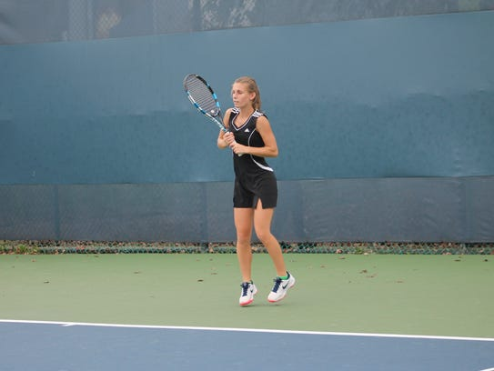 Sophomore Samantha Pregel prepares to hit a shot in