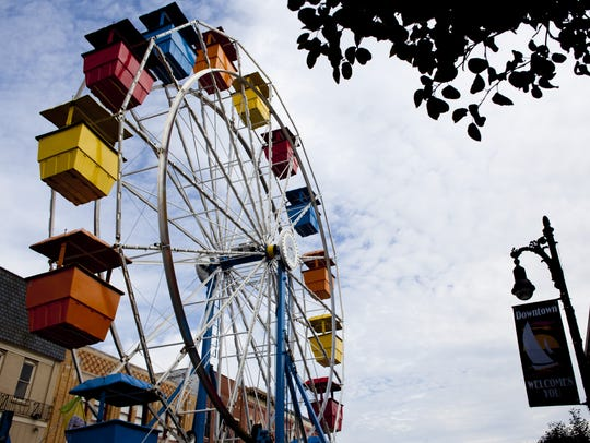 People ride a colorful Ferris wheel during Family Night.