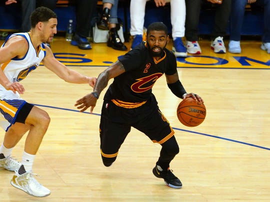 Jun 12, 2017; Oakland, CA, USA; Cavaliers guard Kyrie Irving dribbles against the Warriors in Game 5 of the 2017 NBA Finals at Oracle Arena.