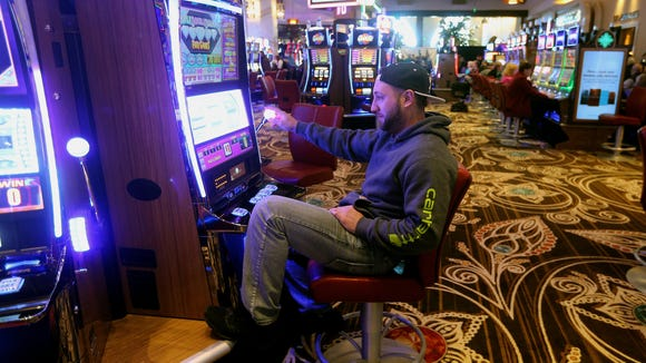 Anthony Palermo, of Rochester, plays a slot machine