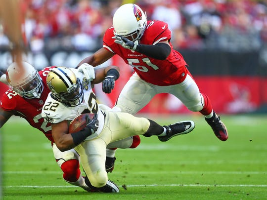 New Orleans Saints running back Mark Ingram (22) is tackled by Arizona Cardinals linebacker Kevin Minter (51) in the first half at University of Phoenix Stadium.